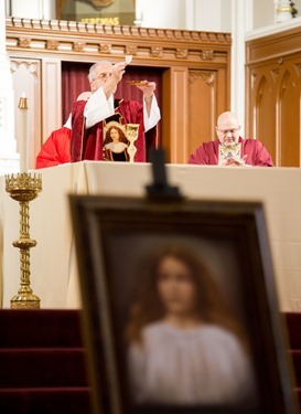 Relics of St. Maria Goretti are venerated at the Cathedral of the Holy Cross Oct. 5, 2015.  The relics were brought to Boston as part of a 25-city tour organized b Treasures of the Church Ministry. Pilot photo/ Gregory L. Tracy