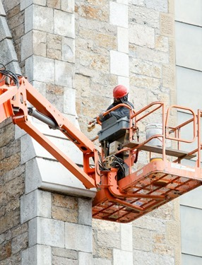 New bells for the Cathedral of the Holy Cross that came from the closed Holy Trinity Church in the South End are lifted in the cathedral's belltower Oct. 23, 2015.Pilot photo/ Gregory L. Tracy