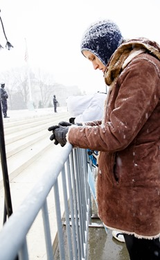 A young woman bows her head at the railing front of the U.S. Supreme Court during the March for Life Jan. 22, 2016. Pilot photo/ Gregory L. Tracy