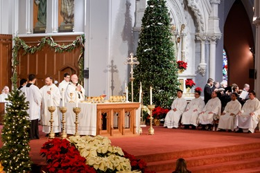 Ordination of Transitional Deacons Chris Bae, Matthew Conley, Patrick Fiorillo, Thomas Gignac, Stephen LeBlanc, Huan Ngo and Thomas Sullivan at the Cathedral of the Holy Cross Jan. 9, 2015. Pilot photo/ Gregory L. Tracy