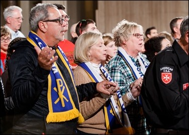 Worshipers join hands in prayer at the Vigil Mass for Life, held Jan. 26 at the Basilica of the National Shrine of the Immaculate Conception in Washington, D.C. Pilot photo/ Gregory L. Tracy