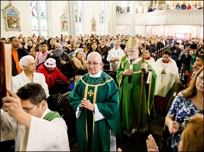 Cardinal Seán P. O'Malley celebrates Mass at Most Holy Redeemer Parish in East Boston Sunday, Feb. 5, 2017. Before the Mass the cardinal, Boston Mayor Martin Walsh and Police Commissioner William Evans addressed the congregation expressing support for the city's immigrant community. Pilot photo/ Gregory L. Tracy