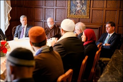 Gov. Charlie Baker, Cardinal Sean O'Malley and Boston Mayor Martin Walsh listen to remarks by  Imam Yasir Fahmy of the Islamic Society of Boston Cultural Center at a gathering hosted by Cardinal O'Malley to bring Boston-area Muslim community leaders together with representatives of the local Catholic and Greek Orthodox Churches and government officials, including Gov. Baker, Mayor Walsh and Boston Police Commissioner William Evans, at the rectory of the Cathedral of the Holy Cross Feb. 2, 2017. Pilot photo/ Gregory L. Tracy