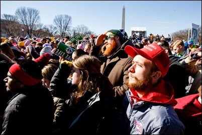 Crowds at the 2018 march for Life watch President Trump's live video address. Pilot Photo/ Gregory L. Tracy