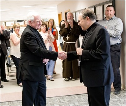 Farewell gathering of Frank Mendez, Dan Nisby and Msgr. William Fay at the Pastoral Center, June 22, 2018. Pilot photo/ Gregory L. Tracy