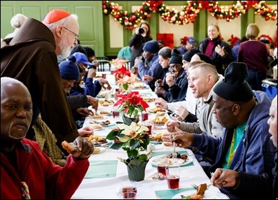Cardinal Sean O'Malley serves Christmas Eve lunch at Pine Street Inn in Boston, Dec. 24, 2018. Pilot photo/ Gregory L. Tracy