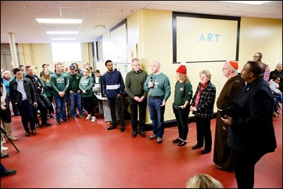 Cardinal Sean O'Malley visits Catholic Charities' Teen Center at St. Peter's in Dorchester, Dec. 24, 2018. Pilot photo/ Gregory L. Tracy