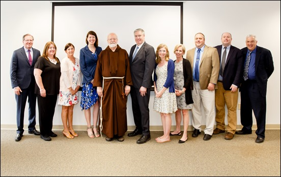 Superintendent of Catholic Schools Thomas Carroll and Cardinal O'Malley present the 2019 Excellence in Education award, June 6, 2019. Pilot photo/ Gregory L. Tracy